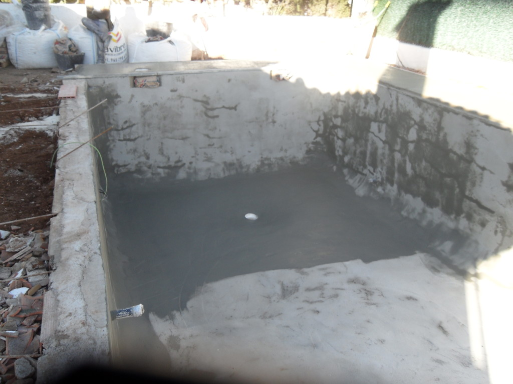 Sealing The Gunite with two coats of waterproofing